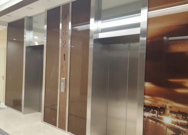 Лифтовые порталы  из нержавеющей стали в новой высотке на Оружейном